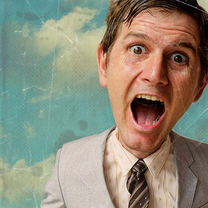 Image is of a man's enlarged head not in proportion with his small old fashioned grey suited torso. He has his mouth open wide as if he's yelling in a happy way. the background is a white cloudy and blue sky.